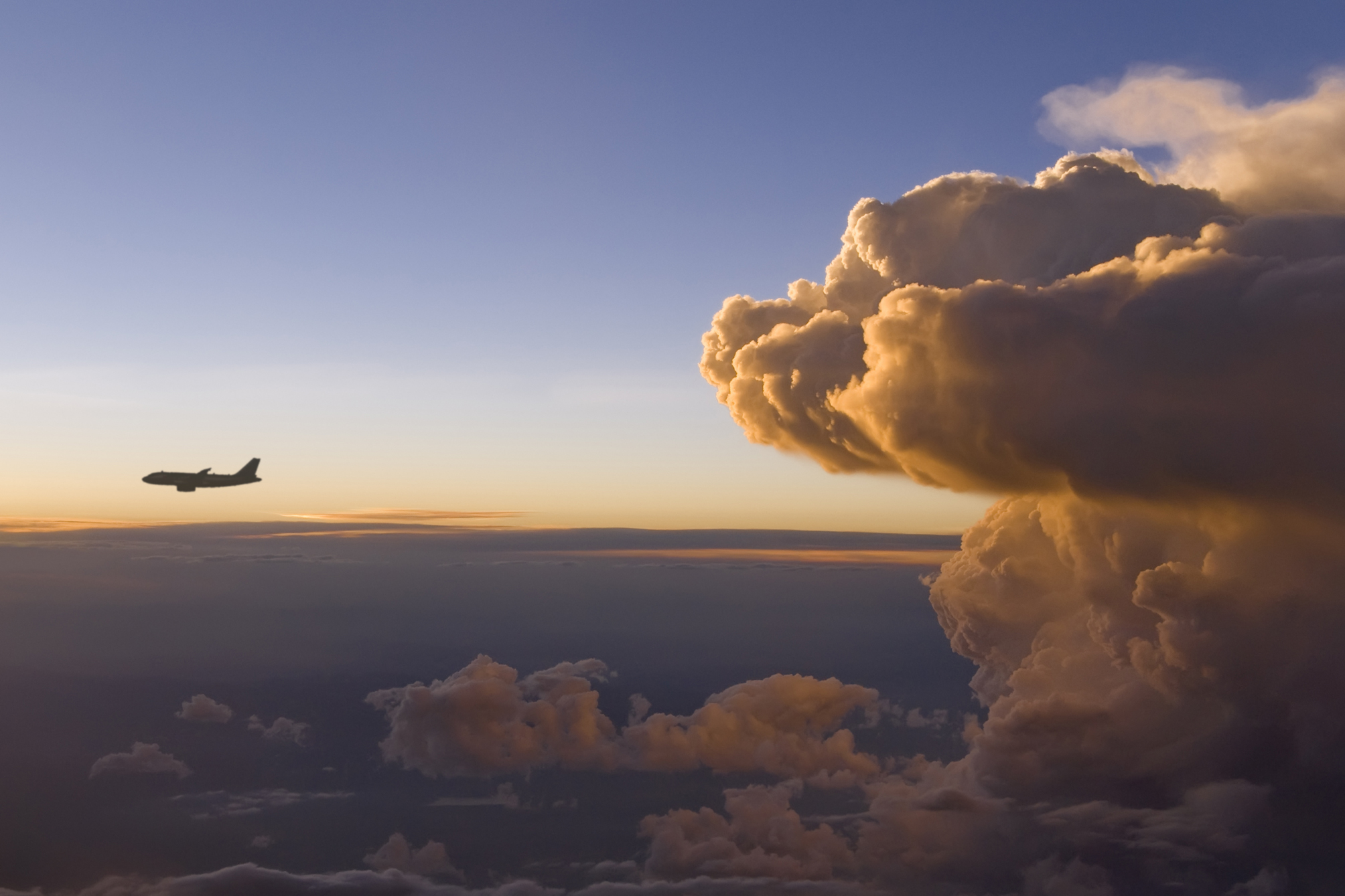 Plane coming out of cloud